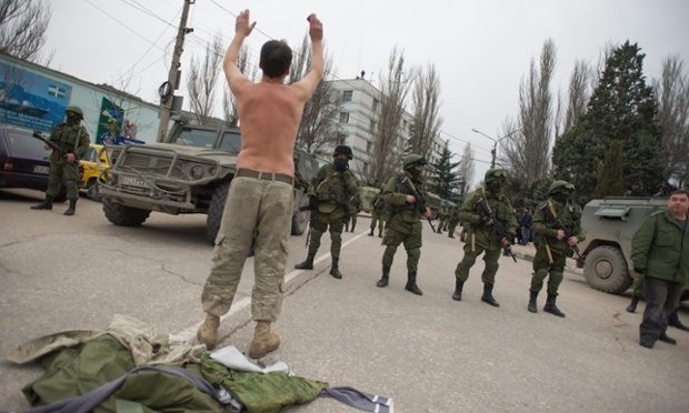 A Ukranian soldier tries to persuade Russian troops to move away from a Ukrainian military base in Balaklava, Crimea on Saturday. Photograph: Anton Pedko/EPA